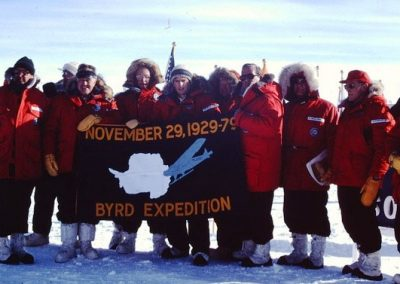 NSF invited guests at 90 degrees south on 50th anniversary of Admiral Byrd's flight to the South Pole, November 29,1979. Banner courtesy of Robert Byrd Breyer (Byrd's grandson).   Guests: Dr. Norman Hackerman, Chairman National Science Board, Senator Harry Byrd, Admiral Byrd's nephew, Robert Byrd Breyer (built dome South Pole station), Admiral Byrd's grandson, Larry Gould, 2nd in command BAE I, Norman Vaughan, dog sled driver BAE I, Robert Woolsey, Undersecretary of the Navy, Thomas Pickering, Assistant Secretary of State, Dr. Grover Murray, National Science Board, Herbert Doan, National Science Board, Morris Busby, Department of State, John Wydler, U.S. House of Representatives. Ross WIlliams, Rear Admiral U.S. Navy