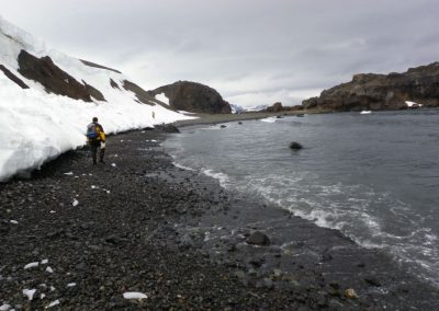 Dr. Ning Zeng of the University of Maryland scours the East Moraine of King George Island's Fildes Peninsula for the most favorable location for collecting soil samples on the 2010 Wilderness Research Antarctic Program